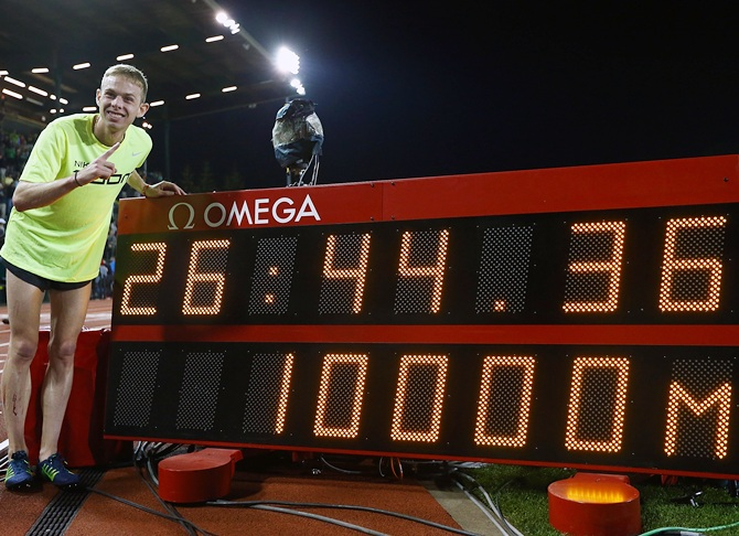 Galen Rupp of USA pose for a photo after setting an American record