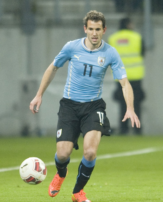 Cristhian Stuani of Uruguay runs with the bal