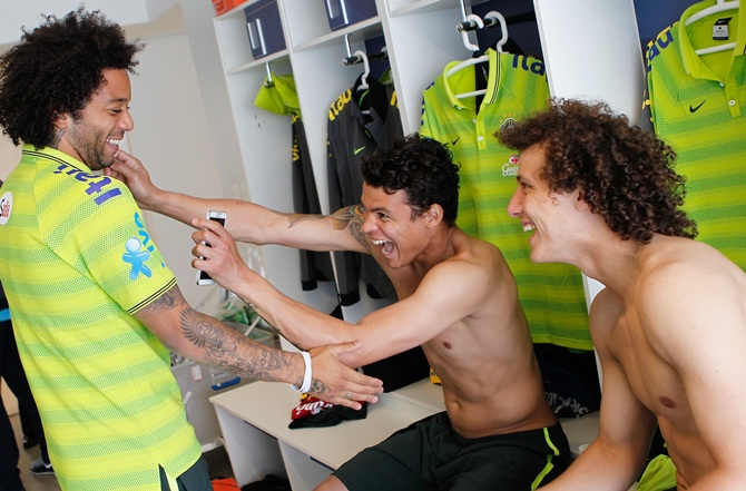 From left, Brazilian national football team players Marcelo, Thiago Silva and David Luiz joke at the squad's Granja Comary training complex, in Teresopolis, 90 km from downtown Rio de Janeiro