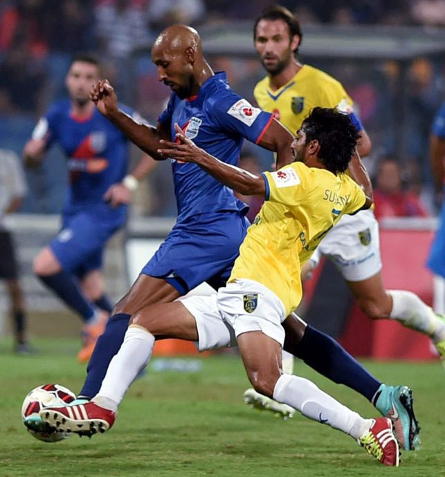 Mumbai City FC's Nicolas Anelka dribbles the ball past Kerala Blasters defenders