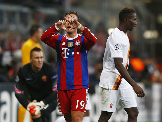 Bayern Munich's Mario Goetze gestures after scoring against AS Roma