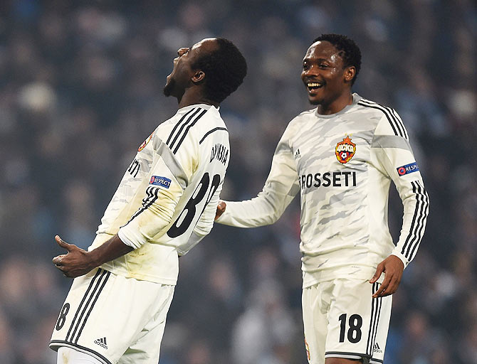 Seydou Doumbia of CSKA Moscow celebrates with Ahmed Musa (right) after scoring against Manchester City