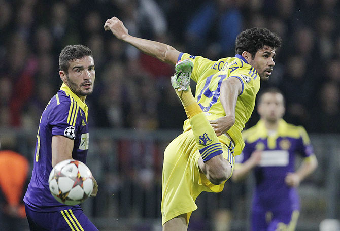 Maribor's Aleksander Rajcevic (left) challenges Chelsea's Diego Costa during their Champions League Group G match at stadium Ljudski vrt in Maribor on Wednesday