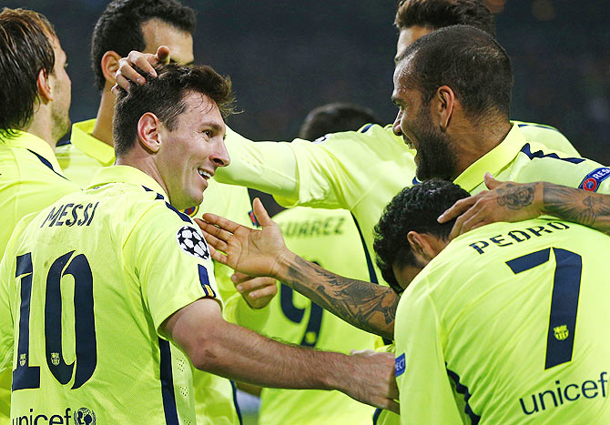 502ccfe8e0f Barcelona's Lionel Messi (L) celebrates his goal with teammates during  their Champions League Group