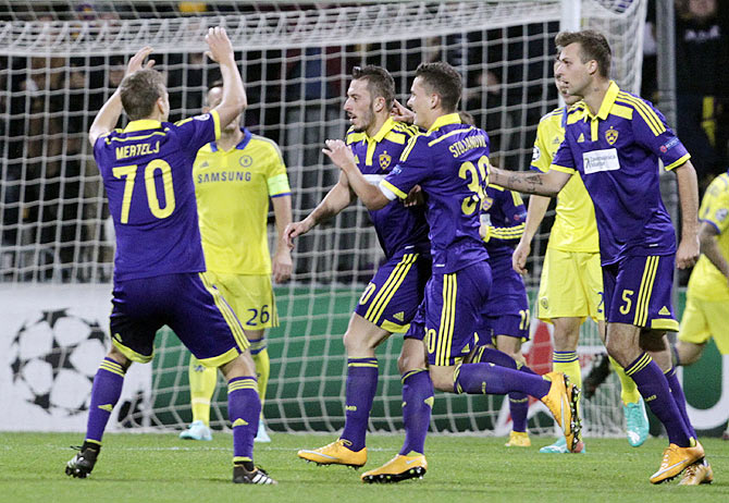 Maribor's Agim Ibraimi (centre) celebrates with team mates after scoring against Chelsea
