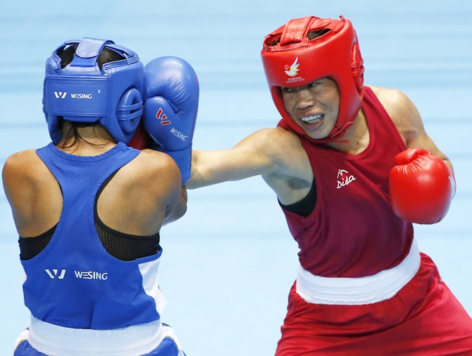 India's M C Mary Kom (red)