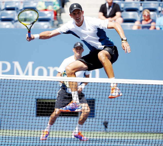 Bob and Mike Bryan in action
