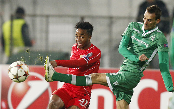 Yordan Minev (right) of Ludogorets challanges Raheem Sterling of Liverpool during their Champions League Group B match at Vassil Levski stadium in Sofia, on Wednesday