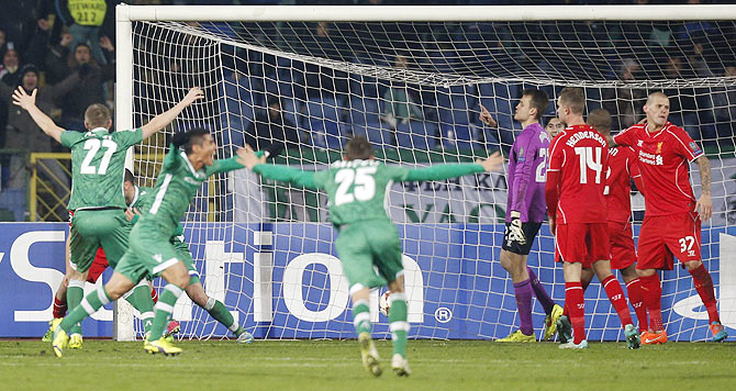 Players of Ludogorets celebrate their second goal against Liverpool on Wednesday