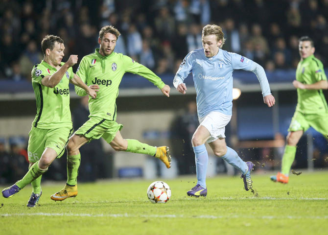 Malmo's Emil Forsberg (2nd from) runs past Juventus' Stephan Lichtsteiner (left) and Claudio Marchisio during their Champions League Group A match on Wednesday