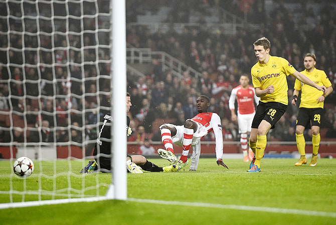 Arsenal's Yaya Sanogo (centre) scores a goal against Borussia Dortmund during their Champions League group D soccer match in London on Wednesday