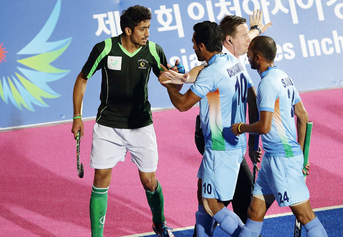 India and Pakistan players get into a heated discussion during their Asian Games final on Thursday