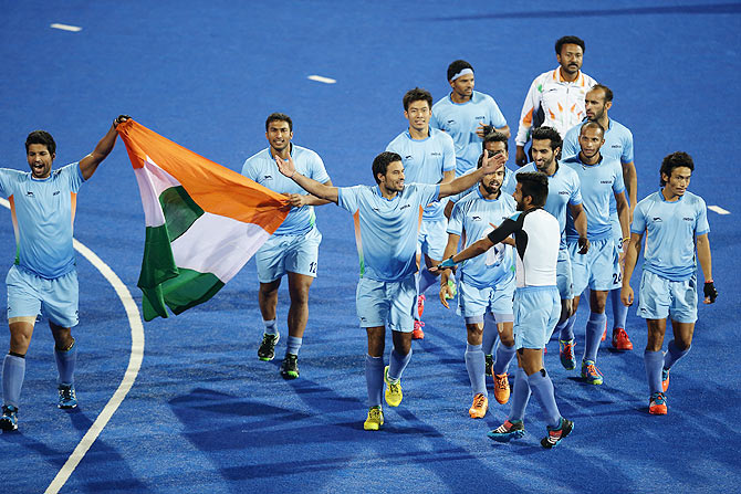 India players celebrate after defeating Pakistan to win the men's hockey gold medal at the 2014 Asian Games at Seonhak Hockey Stadium in Incheon on Wednesday.