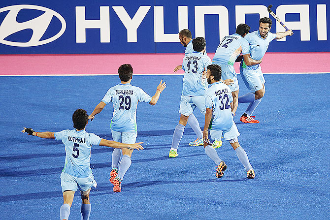 India players celebrate after the scoring the winning goal to win the hockey gold medal on Thursday.