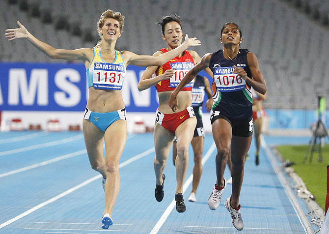 Kazakhstan's Margarita Mukasheva (left) celebrates crossing the line ahead of India's Tintu Luka (right) and China's Zhao Jing in the women's 800m final at the Incheon Asiad Main Stadium during the 17th Asian Games on Wednesday.