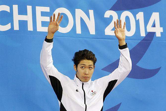 Gold medalist Kosuke Hagino of Japan celebrates during the victory ceremony for the men's 400m individual medley final