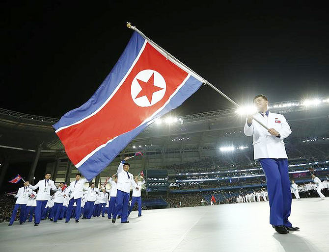 Flag bearer of North Korea Sok Yongbom leads the team into the Opening Ceremony of the 17th Asian Games in Incheon September 19, 2014