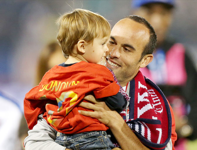 Landon Donovan shares a quiet moment with his son after his final international match of his career on Friday