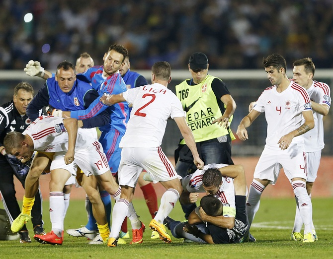 Fans and players of Serbia and Albania clash