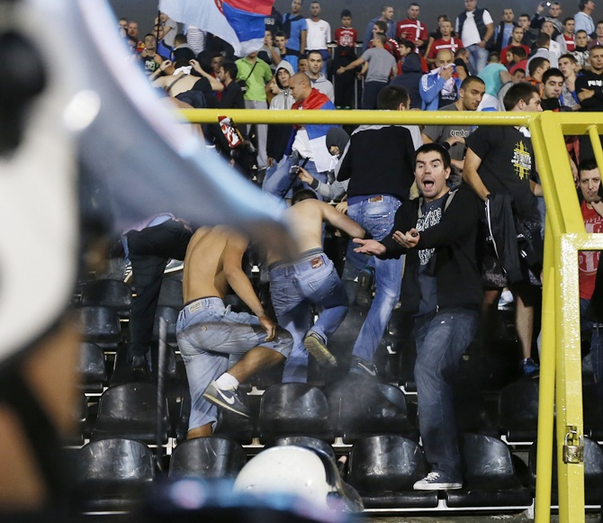 Fans of Serbia confront the riot police