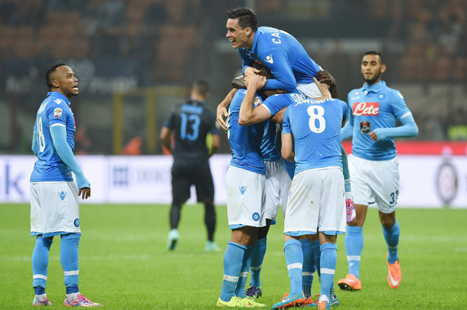 Jose Maria Callejon of SSC Napoli celebrates with teammates after scoring his second goal  during their Serie A match against Inter Milan at Stadio Giuseppe Meazza in Milan on Sunday