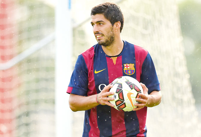 Rediff Sports - Cricket, Indian hockey, Tennis, Football, Chess, Golf - Luis Suarez feared Barca would not sign him after biting ban