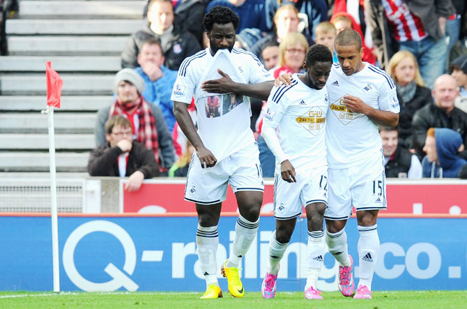 Swansea player Wilfried Bony (left) celebrates after converting a penalty against Stoke City