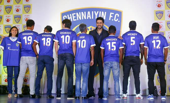 Co-owners Abhishek Bachchan (centre) and Vita Dani (extreme left) with Chennaiyin FC players at the launch of the team jersey in Mumbai