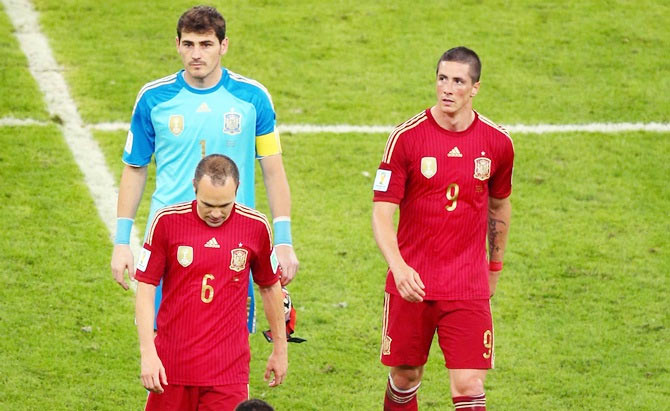 Andres Iniesta,Iker Casillas and Fernando Torres of Spain walk off the pitch