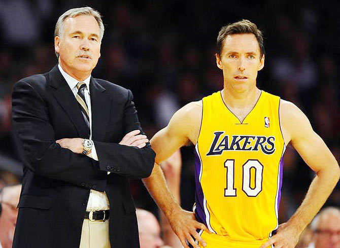 Los Angeles Lakers head coach Mike D'Antoni (left) stands with guard Steve Nash (10)