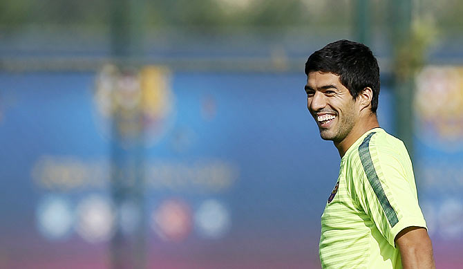Barcelona's players Luis Suarez smiles during a training session