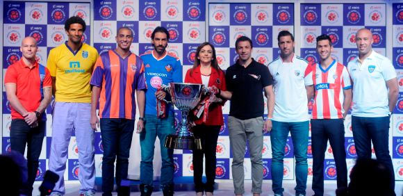 ISL players during the unvieling of the trophy in Mumbai in 2014