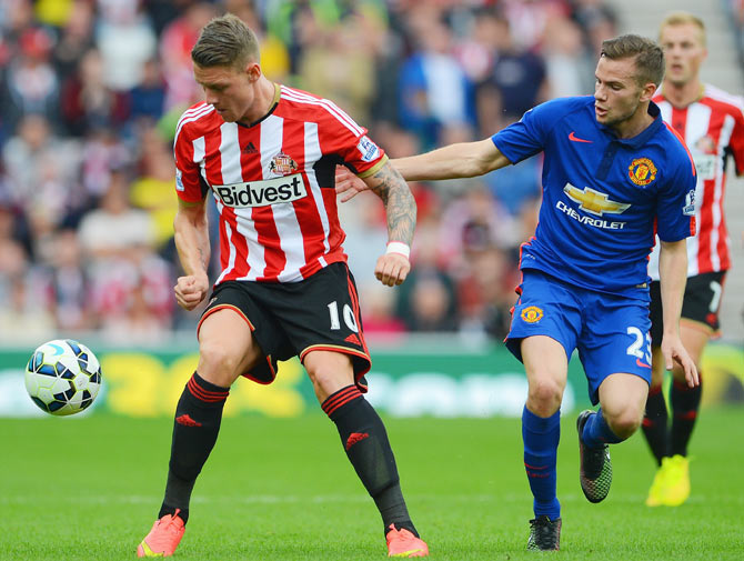 Connor Wickham of Sunderland is closed down by Tom Cleverley of Manchester United during their Barclays Premier League match