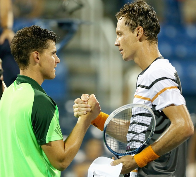 Tomas Berdych, right, of the Czech Republic shakes hands with Dominic Thiem of Austria