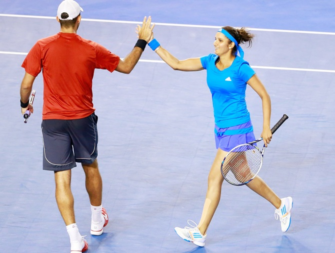 Sania Mirza of India and Bruno Soares of Brazil celebrate