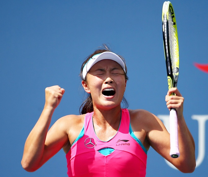 Shuai Peng of China celebrates