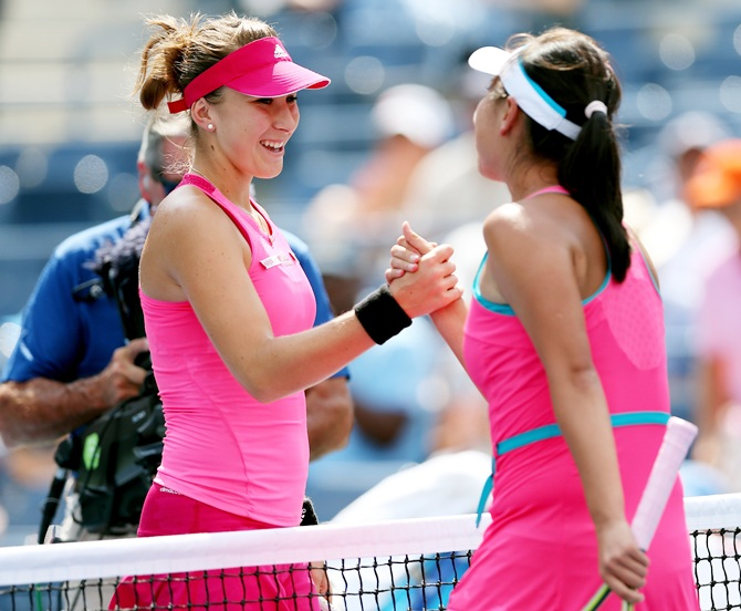 Shuai Peng of China shakes hands with Belinda Bencic