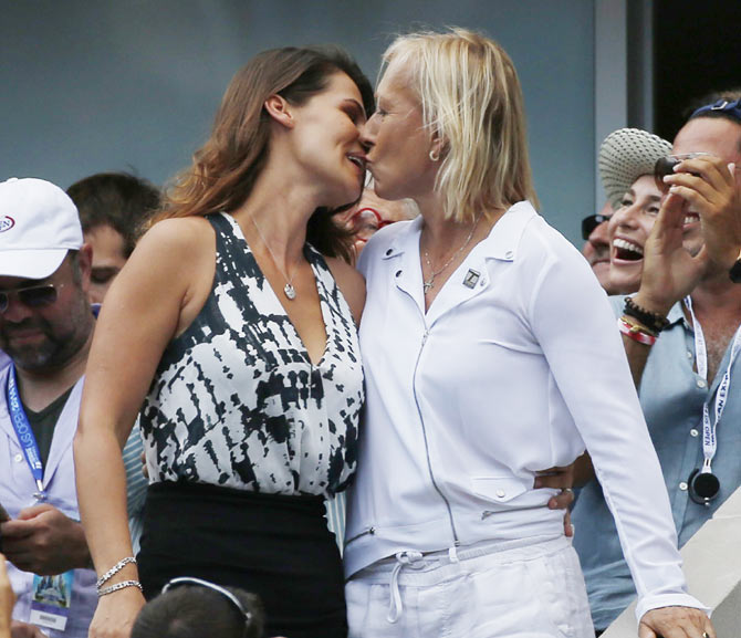 Navratilova kisses her girlfriend after the proposal