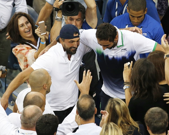 Croatia's Marin Cilic and celebrates with his then coach Goran Ivanisevic after winning the 2014 US Open title