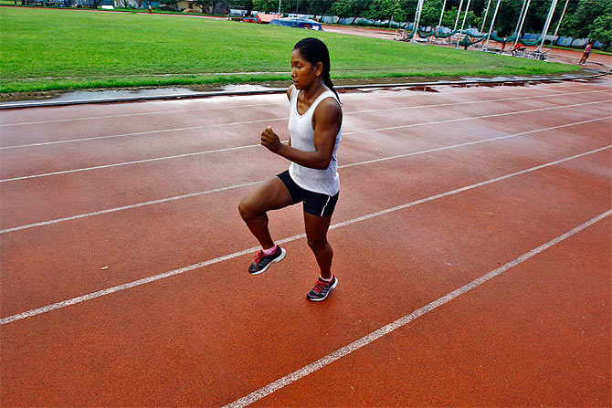 Heptathlete Swapna Barman runs during a practice session at Salt Lake stadium in Kolkata August