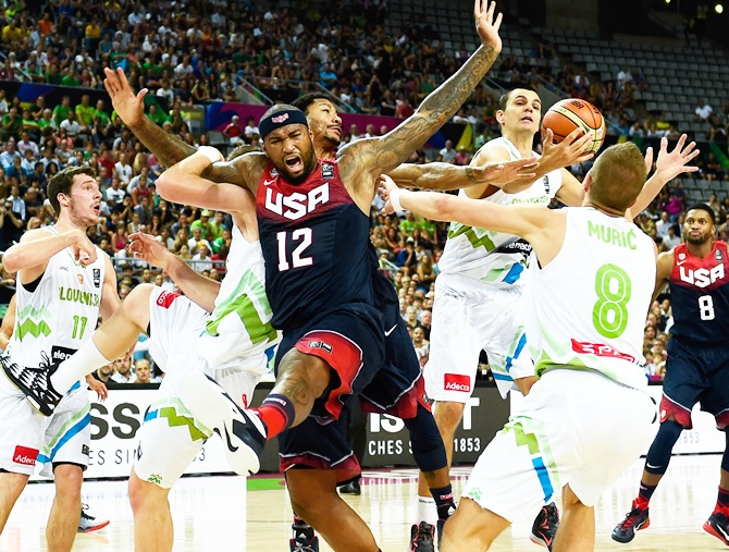 DeMarcus Cousins of the USA Basketball Men's National Team duels for the ball   with Slovenia Basketball Men's National Team players