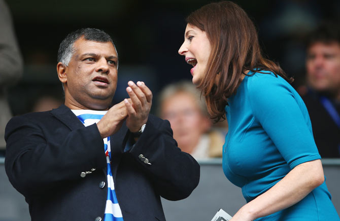 QPR Chairman Tony Fernandes and a friend during the Barclays Premier League match between Queens Park Rangers and Sunderland at Loftus Road on August 30, 2014