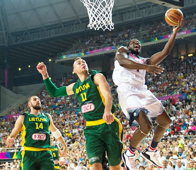 Kenneth Faried of the USA BasketballMen's National Team shoots against Lithuania's Donatas Motiejunas