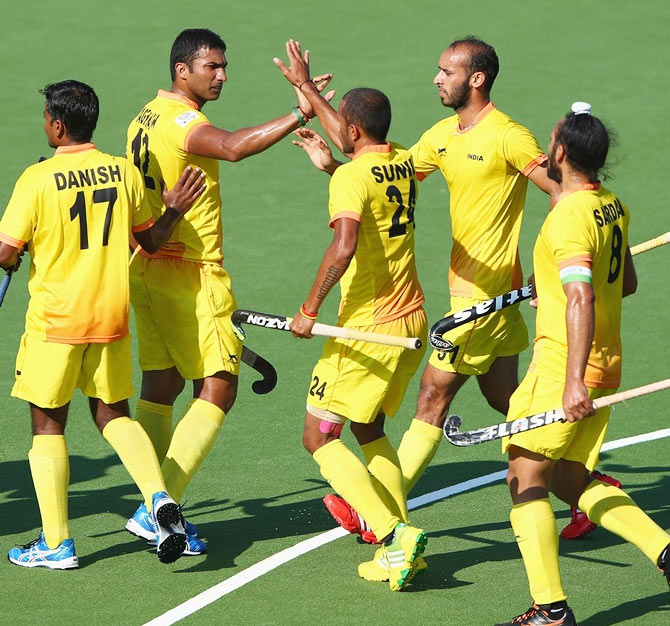 VR Raghunath of India celebrates after scoring from a penalty corner during the Mens Hockey match between India and Wales