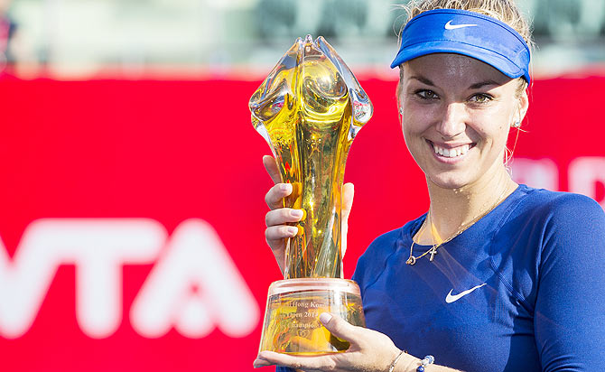 Sabine Lisicki of Germany poses with the trophy after winning the Hong Kong Tennis Open against Karolina Pliskova of Czech Republic