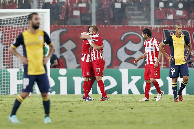 Champions League: Olympiakos stun last season's finalists Atletico Madrid