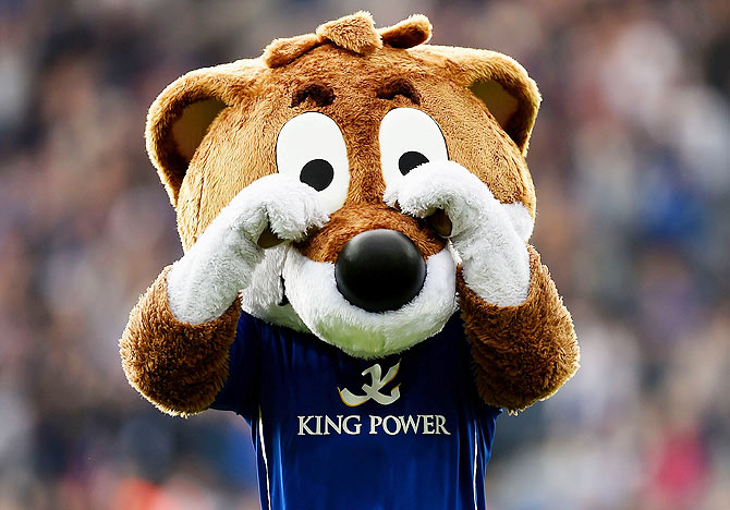 Filbert the Leicester City mascot 'cries' infront of the Manchester United fans following his team's 5-3 victory during the Barclays Premier League match on Sunday