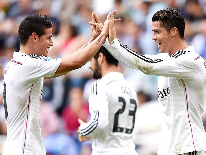 Cristiano Ronaldo of Real Madrid CF celebrates with his teammate James Rodriguez