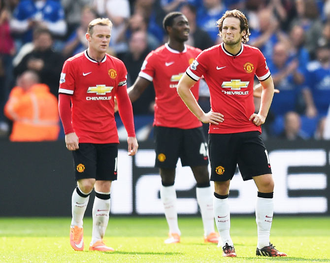 (Left-Right) Manchester United players Wayne Rooney, Tyler Blackett and Daley Blind wear a dejected look.