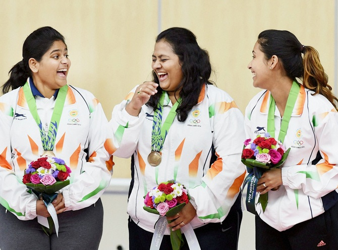 Rediff Sports - Cricket, Indian hockey, Tennis, Football, Chess, Golf - India at Games: Shooters, Pallikal win bronze; Ghosal in final